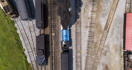 Aerial View of Train Yard Waiting for Thomas the Train Puffing Smoke on a Sunny Summer Day