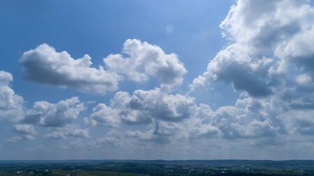White and Dark Fluffy Clouds Floating in the Bright Blue Skies on a Summer Day