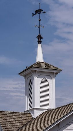 View of a Steeple Cupolas with a Weather Vane on a Sunny Summer Day