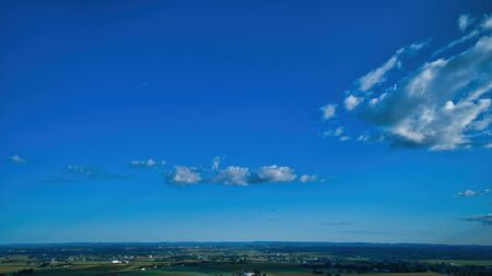 Blue sky and multiple clouds background showing a horizon 스톡 콘텐츠 - 147957354
