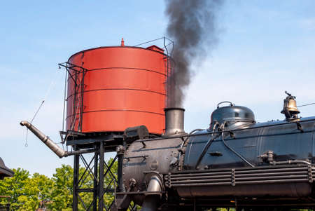 An old train with smoke coming out of its chimney 스톡 콘텐츠 - 150809489