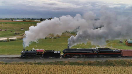 A high angle shot of an old train with smoke coming out of is chimney 스톡 콘텐츠