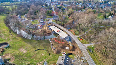 Aerial View of a New Bridge being Constructed over a Creek on a Sunny Winter Day