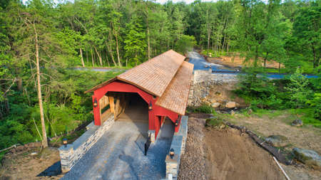 Aerial View of a Restored Covered Bridge and Stone Works