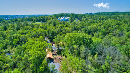 Aerial View of a Restored Covered Bridge and Stone Works on a Sunny Day Foto de archivo
