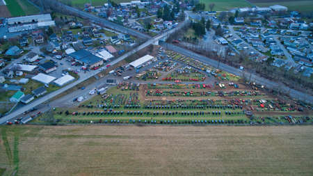 Aerial View of an Amish Mud Sale with Lots of Buggies and Farm Equipment on a Winter Day