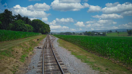 Old Rail Road Track going Thru Countryside on a Sunny Day Foto de archivo