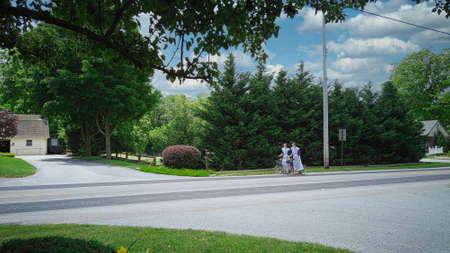 Gordonville, Pennsylvania, June 2020 - 2 Amish Girls Traveling on Scooters Editorial