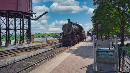 Strasburg, Pennsylvania, July 2020- Antique Steam Locomotive Steaming up at Rail Road Station on a Sunny Day Editorial