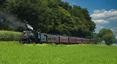 Strasburg, Pennsylvania, July 2007 - Steam Passenger Train Waiting to Pull out of Small Countryside Station on a Sunny Day Editorial