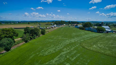Aerial View of Farmlands a Rail Road Track and a Play Area in Summer on a Beautiful Day 스톡 콘텐츠