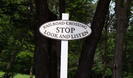 A Rail Road Stop Sign of Stop Look and Listen