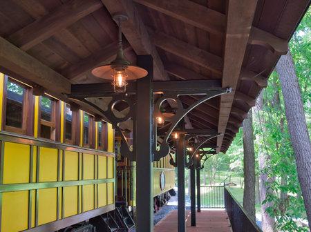 A Train Station Platform with an Antique Passenger Car 스톡 콘텐츠