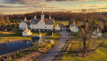 An Aerial View at Sunset of Antique Restored Barns 스톡 콘텐츠