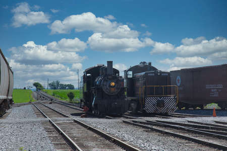 Strasburg, Pennsylvania, July 2018 - A 1906 Steam Locomotive and a Diesel Locomotive Seating Side by Side