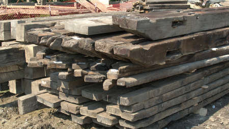 Pile of Old Timbers Being Tagged and Stored for Later Use 스톡 콘텐츠