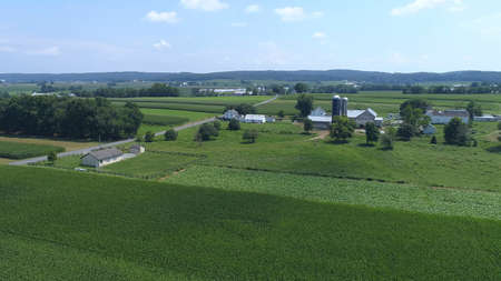Aerial View of an Amish One Room School House in the Middle Of Amish Farmlands on a Sunny Day 스톡 콘텐츠