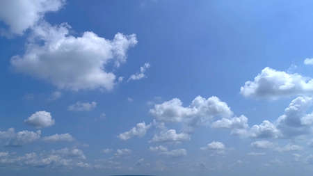 Blue Sky with White Fluffy Clouds as a Back Ground 스톡 콘텐츠