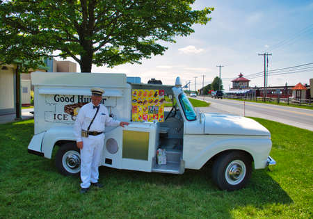 Strasburg, Pennsylvania, June 2018 - Old Restored Good Humor Ice Cream Truck and Owner Parked on Grass Selling Ice Cream