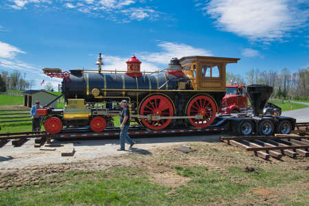 Elizabethtown, Pennsylvania, December 2018 - View of a Replica 1860s Steam Locomotive Being Placed on a Rail Road Track and Assembled
