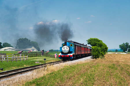 Ronks, Pennsylvania, July 2018 - Aerial View of Thomas the Tank Engine Puffing and Steaming along the Countryside