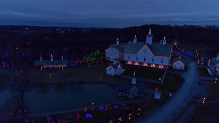 Aerial View of a Large Christmas Display Covering Buildings and Grounds Taken at Dusk