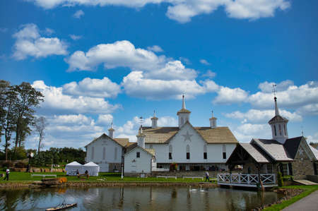 View of Barns and a Pond and Other Buildings on a Beautiful Sunny Day