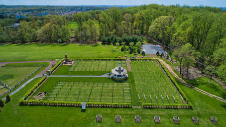 Aerial View of Restored Barns and Surrounding Buildings on a Beautiful Grounds on a Beautiful Spring Day