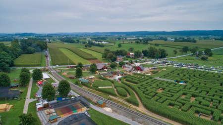 Aerial of Empty Rail Road Track Thru Farmlands on a Cloudy Day