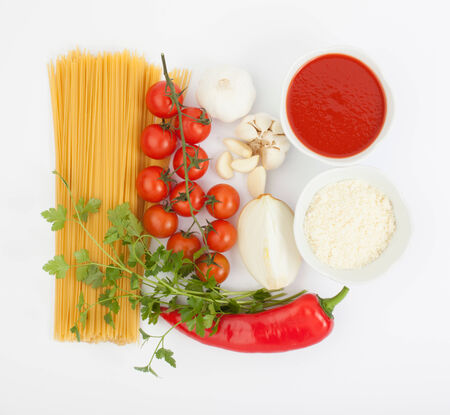 ingredients for spaghetti bolognese isolated on white photo