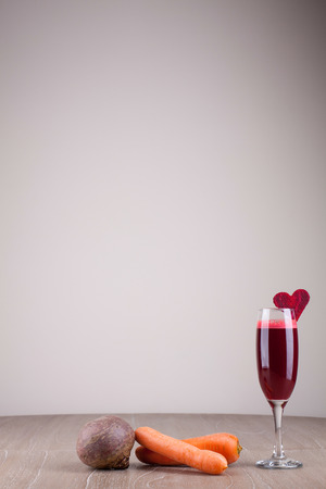 freshly squeezed beet and carrot juice decorated with beetroot heart photo