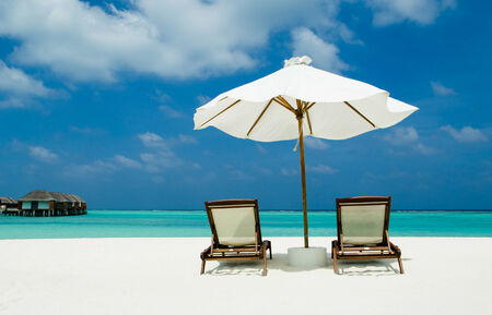 sunbeds with parasol on Maldives
