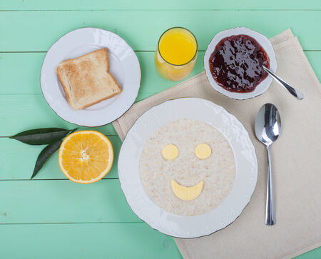 minty: cheerful breakfast with orange juice, jam and toast