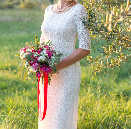 bride with bouquet boho style photo
