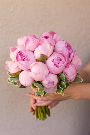 peonies: wedding bouquet of pink peonies