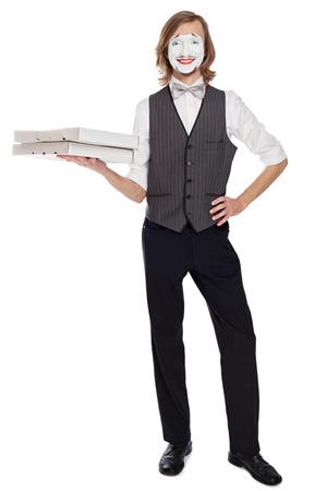 mimo: Artista de m�mica celebraci�n de cajas de pizza retrata la entrega de pizza Foto de archivo