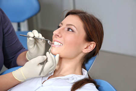 dental examination: dental examination of attractive girl in the office of the dentist