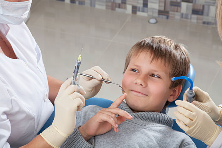boy on dental checkups do not want to put an injection of anesthesia Stock Photo