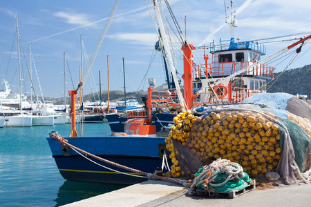 berth: old fishing boat in the port berth Editorial