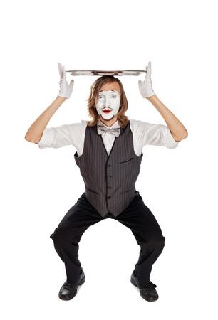 mimo: actor de mimo sosteniendo un plato vacío Foto de archivo