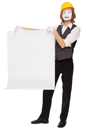 mime: mime actor plays a builder who shows a white sheet Stock Photo