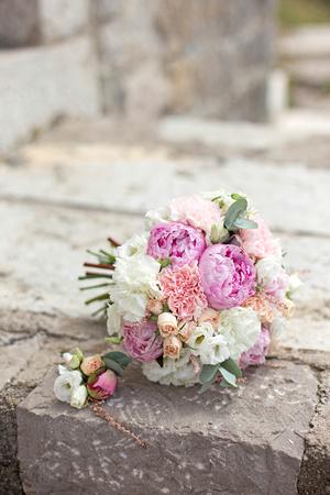 wedding decor: bridal bouquet on a stone