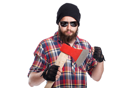 hatchet man: Confident young bearded man holding an axe and looking at camera while standing against white background
