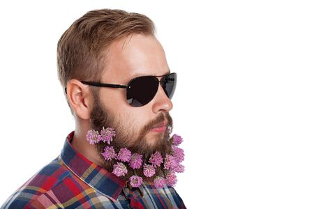 coiffeur: Portrait of handsome man with beard of clover flowers isolated on white