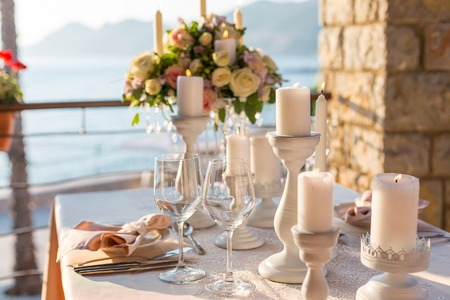 table decoration: table decorated with flowers wedding dinner. Stock Photo