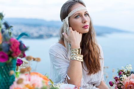 bohemia: girl with a wedding bouquet boho style, sea background