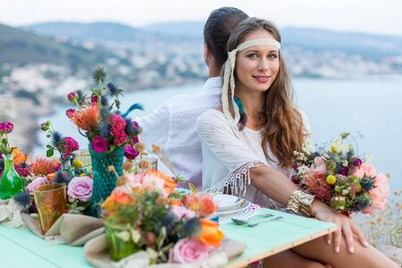 beautiful blonde: girl with a wedding bouquet boho style, sea background