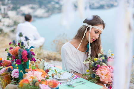 bride and groom background: girl with a wedding bouquet boho style, sea background