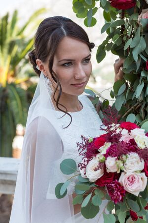 arm bouquet: Beautiful young bride outdoors with a bouquet