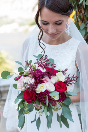 sexy bride: Beautiful young bride outdoors with a bouquet